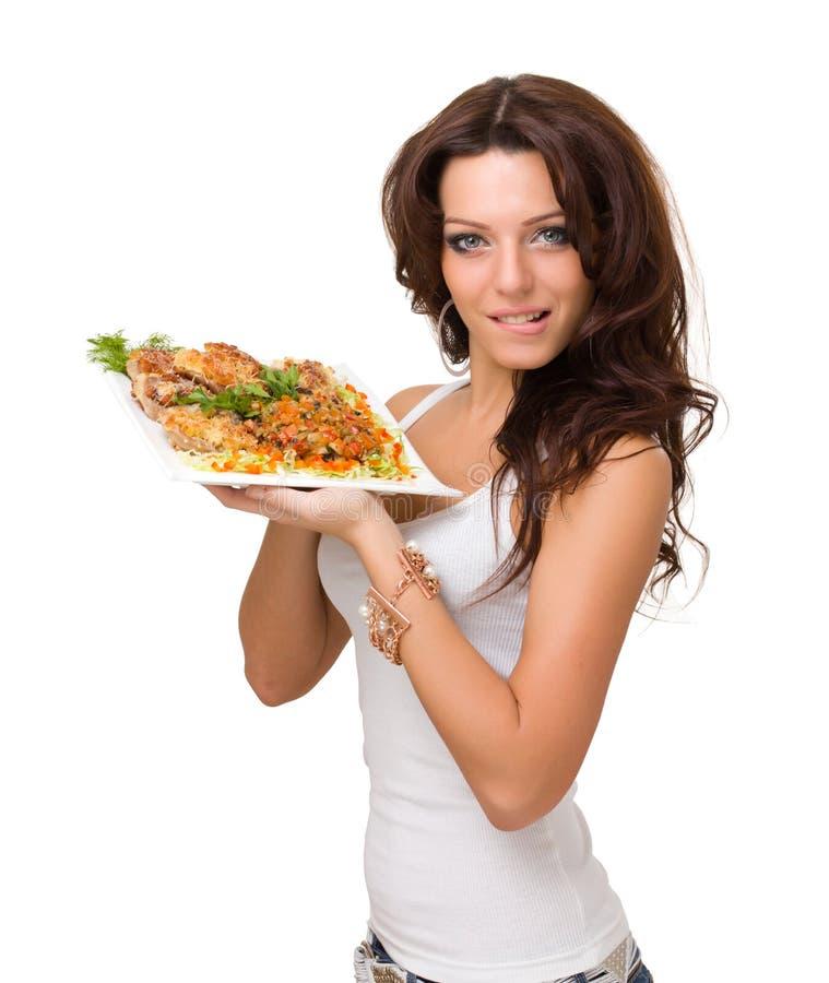 Het jonge vrouw stellen met een maaltijd stock foto's