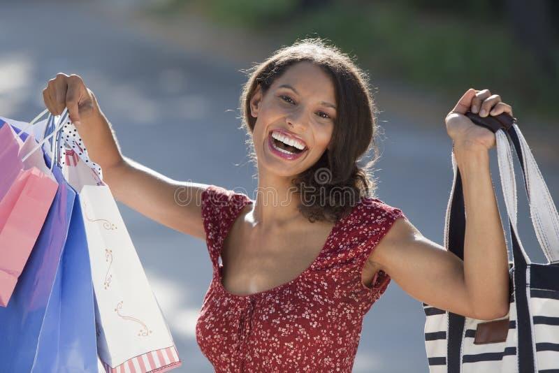 Het jonge Winkelen van de Vrouw royalty-vrije stock foto
