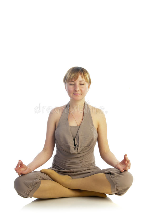 Het jonge zwangere vrouw mediteren stock fotografie