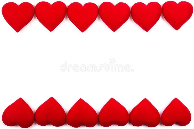Het kader van de groetkaart van rode harten op een witte achtergrond met Co royalty-vrije stock fotografie