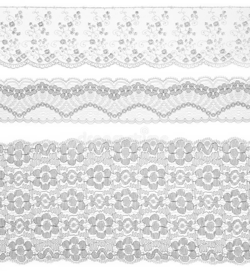Het kant maakt lint over wit in orde. Reeks van stof. royalty-vrije stock fotografie