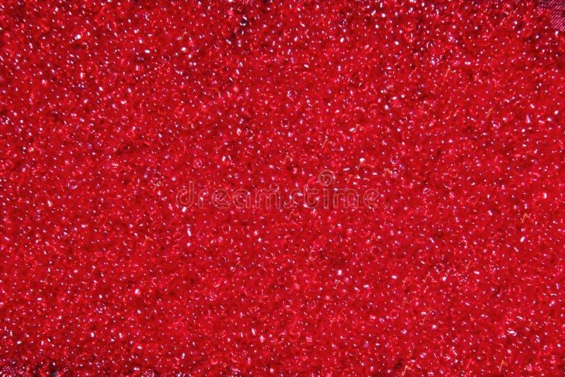 Het karmozijnrood-rode glas parelt achtergrond - de textuur van close-upparels royalty-vrije stock foto's