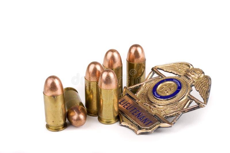 Het kenteken en de kogels van de politie royalty-vrije stock afbeelding