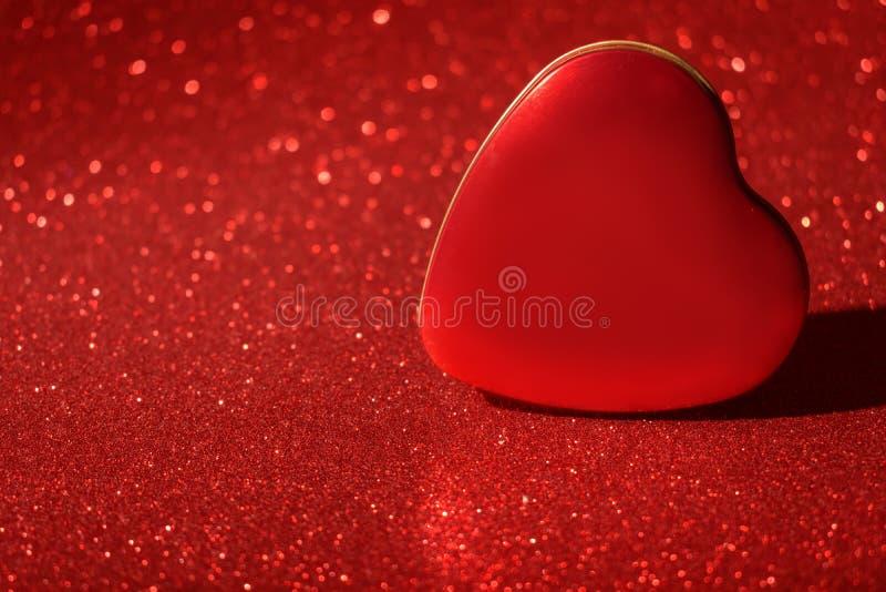 Het Kerstmisnieuwjaar Valentine Day Red Heart Box schittert achtergrond Stof van de vakantie de abstracte textuur Element, flits stock fotografie