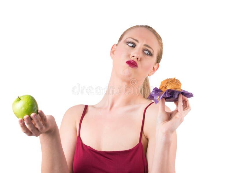 Het kiezen tussen gezond en vettig voedsel royalty-vrije stock foto