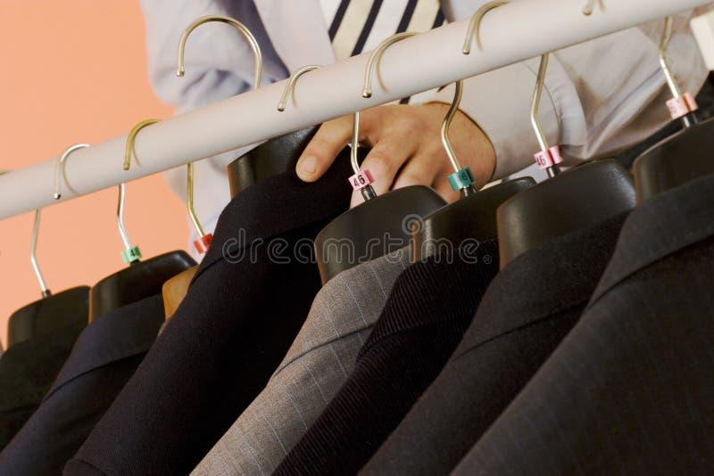 Het kiezen van het kostuum stock fotografie