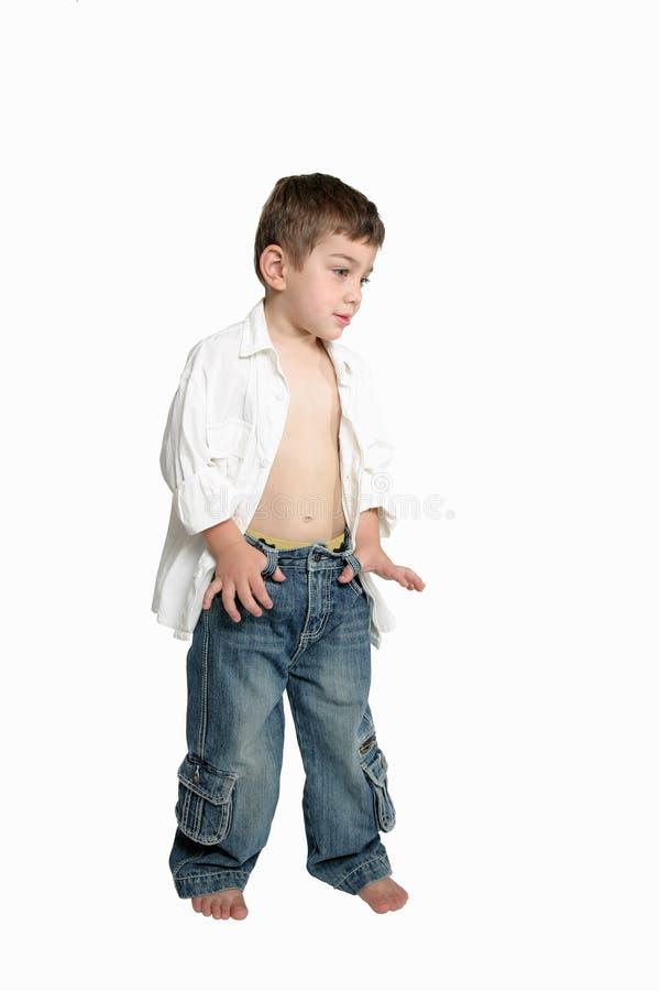 Het kind met dient jeans in royalty-vrije stock foto's