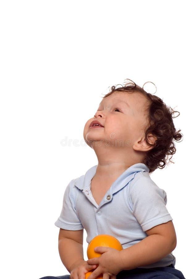 Het kind met sinaasappel. royalty-vrije stock afbeeldingen