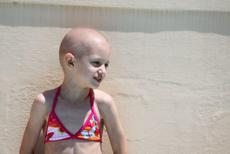 Het kind slaat kanker royalty-vrije stock afbeeldingen
