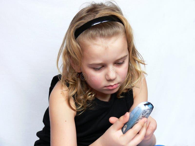 Het kind texting stock foto's
