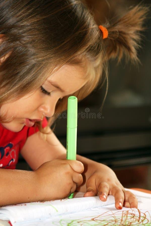 Het kind trekt stock afbeeldingen