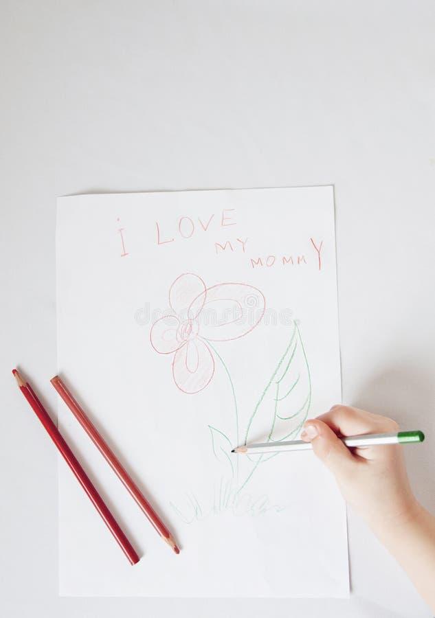 Het kind trekt een bloem stock fotografie