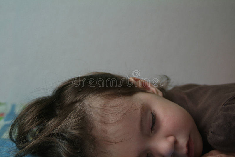 Het kind van de slaap stock afbeeldingen