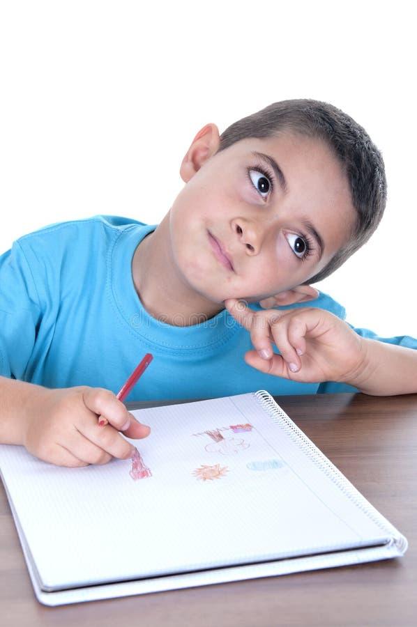 Het kind van de student het bestuderen stock foto