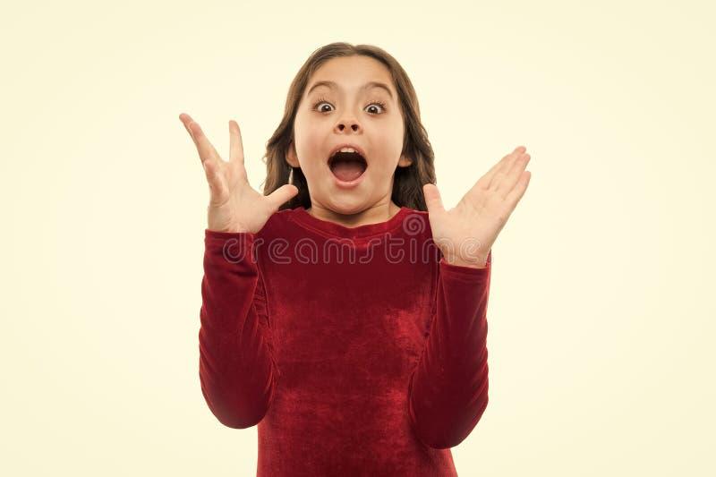 Het kind wekte emotioneel op kan niet haar ogen geloven Verbazende emotie Uitdrukking van het meisjes de leuke opgewekte gezicht  stock foto