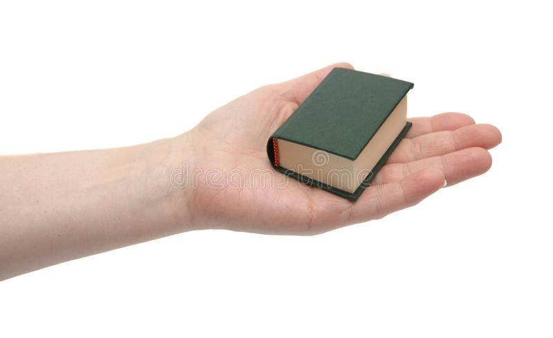 Het kleine boek in een hand royalty-vrije stock afbeeldingen