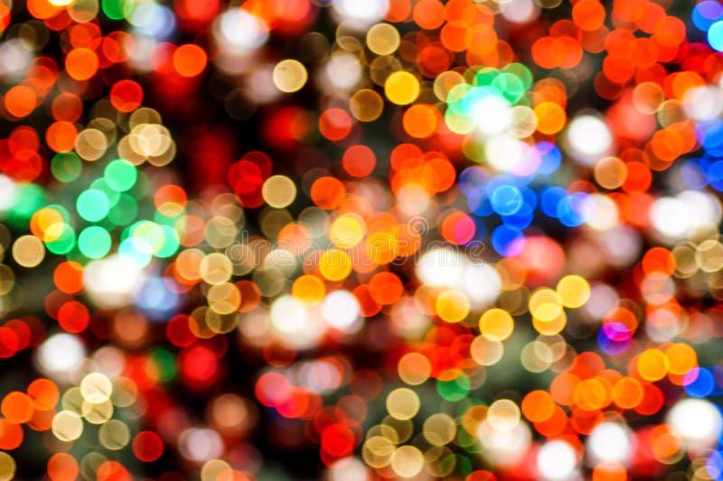 Het kleurrijke vage Kerstmislichten schitteren stock afbeelding