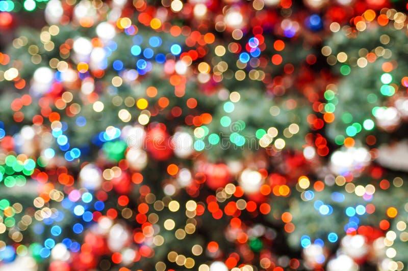 Het kleurrijke vage Kerstmislichten schitteren royalty-vrije stock fotografie