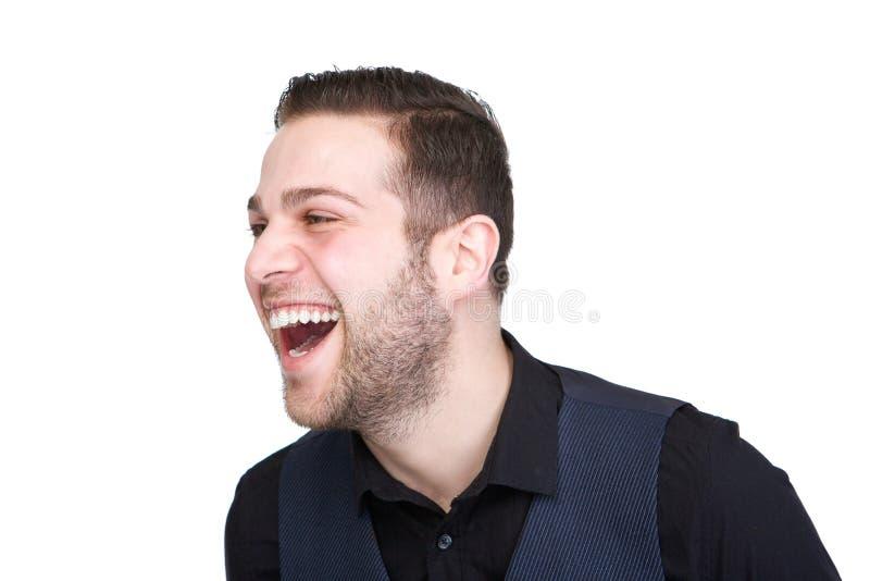 Het knappe jonge mens lachen stock afbeelding