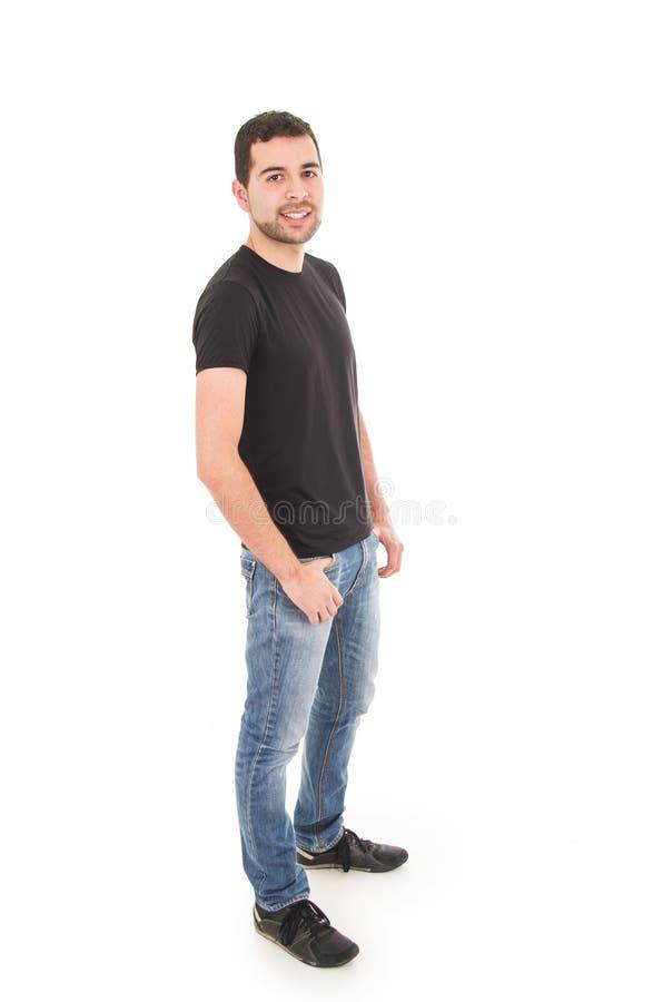 Het knappe Latijnse kerel stellen met jeans en zwart t royalty-vrije stock foto's