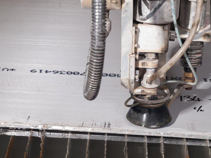 Het knipsel van de waterdruk door roestvrij staalmaterialen stock foto
