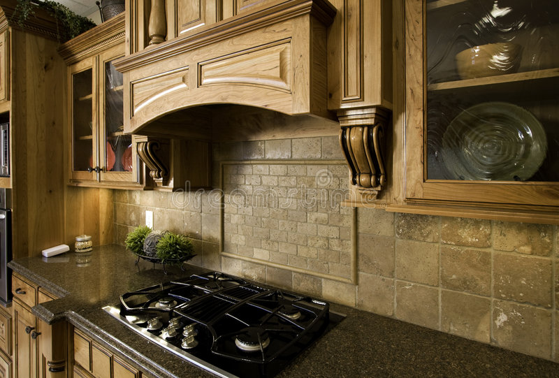 Het koken en het onderhouden in luxe stock afbeeldingen