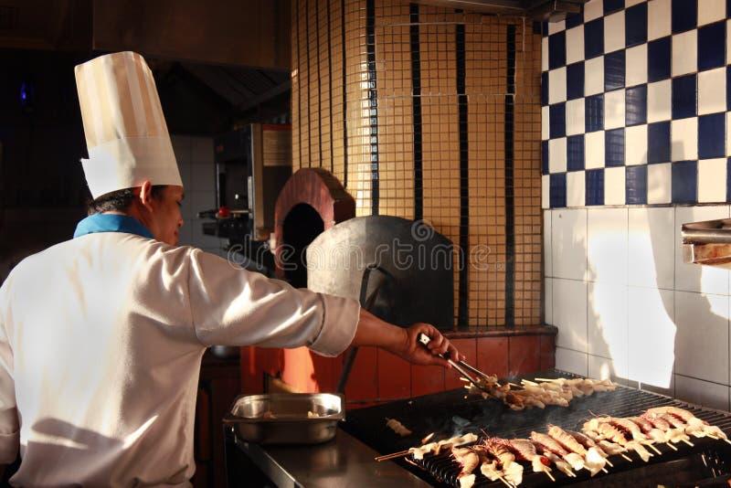 Het koken van de chef-kok royalty-vrije stock afbeeldingen