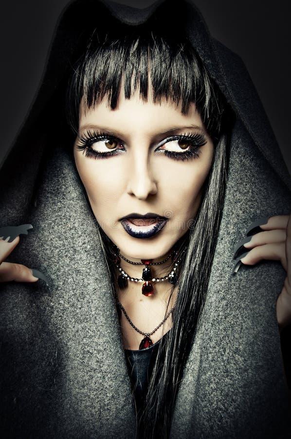 Het kostuum en maakt omhoog van sexy heks stock foto