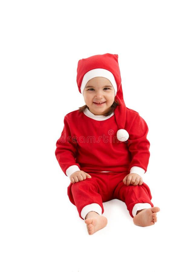 Het kostuum van de kerstman op weinig jong geitje royalty-vrije stock afbeeldingen