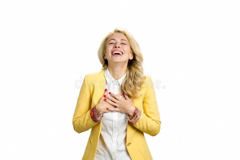 Het lachen jonge blonde, witte achtergrond royalty-vrije stock foto