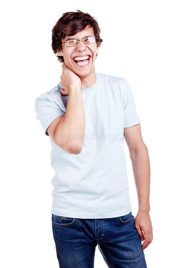 Het lachen kerel met hand op hals royalty-vrije stock afbeelding
