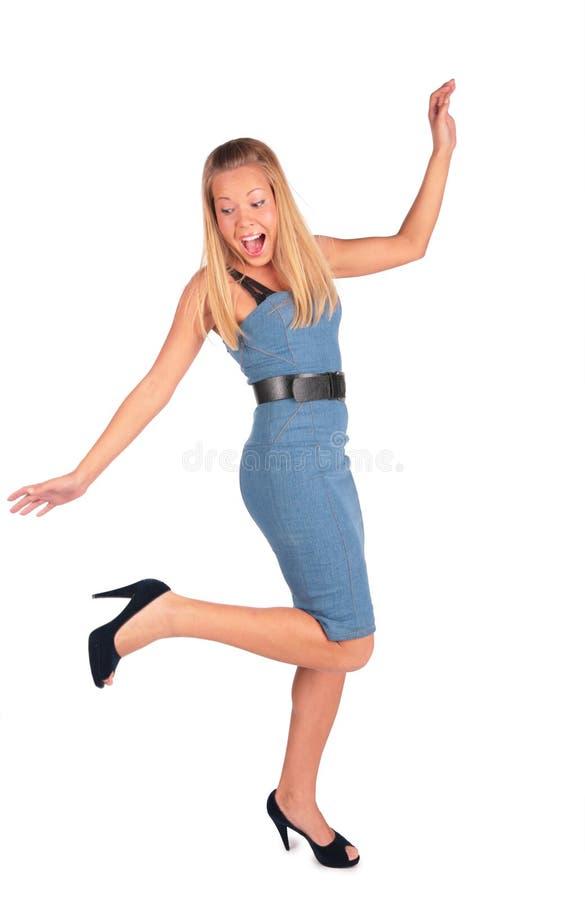 Het lachen meisjestribune op één voet stock foto