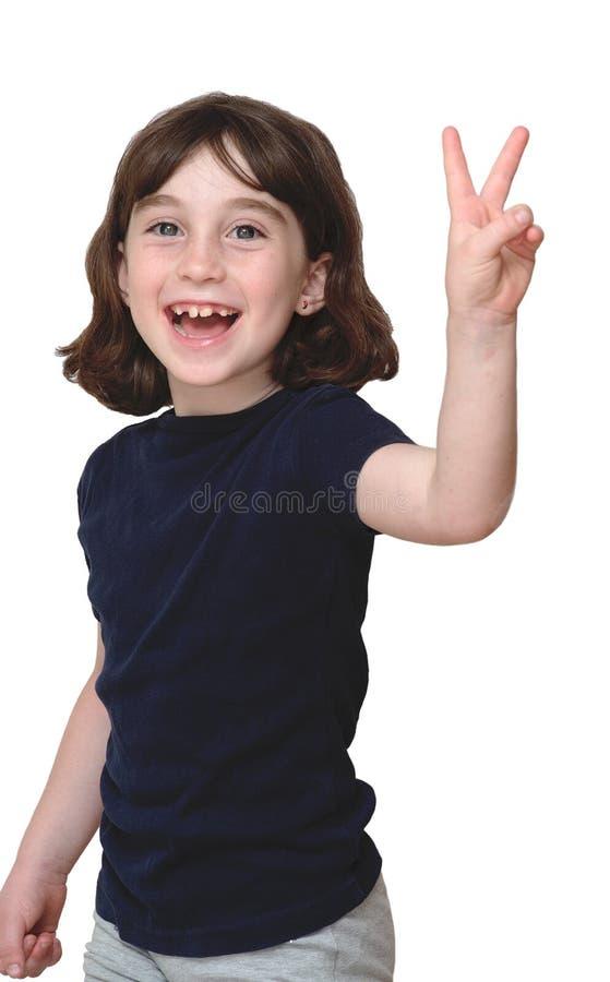Het lachende leuke meisje toont v-Teken stock afbeeldingen