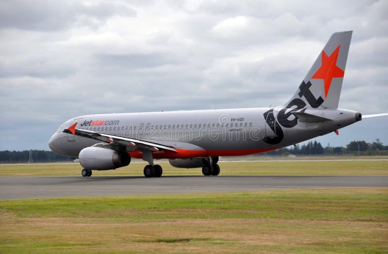 Het Land van Jetstar A320 bij Luchthaven Christchurch stock afbeeldingen