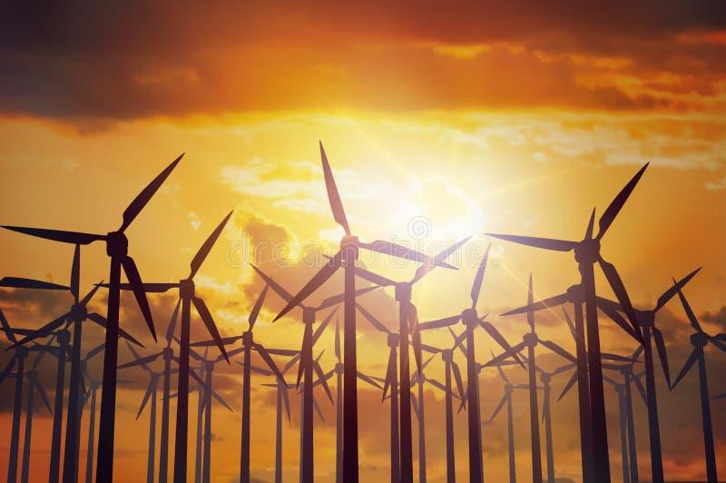 Het landbouwbedrijf van windturbines bij zonsondergang De industrie en energiegeneratieconcept stock foto's