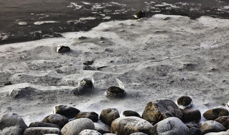 Het Landschap van de winter. Ijs op stenen, Wadden overzees, Esbjerg, Denemarken royalty-vrije stock foto's