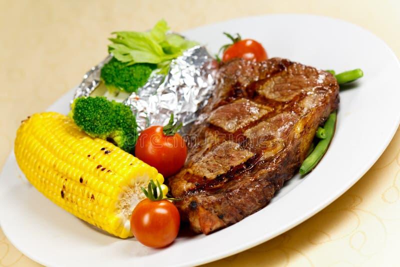 Het Lapje vlees van de Strook van New York met Groenten stock afbeelding