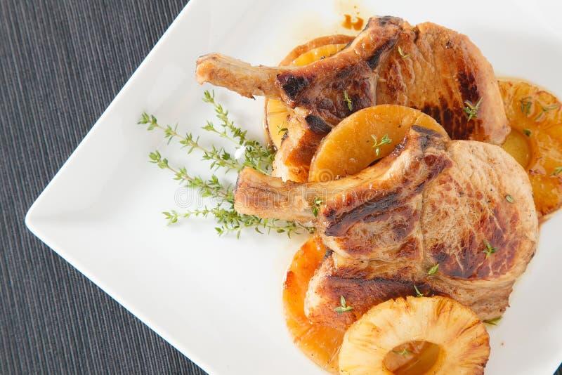 Het lapje vlees van varkensvleesribben met ananas royalty-vrije stock afbeelding