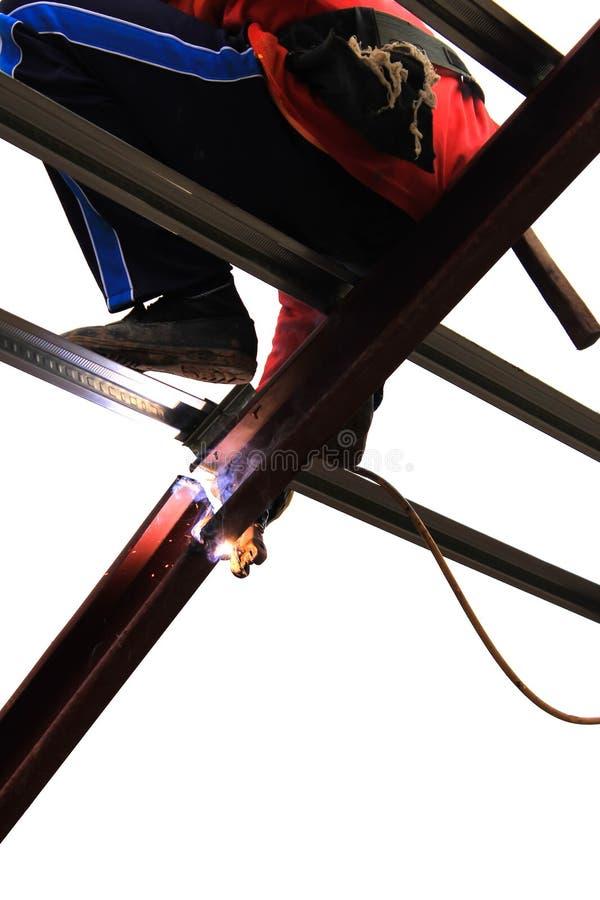 Het lassenmetaal van de arbeider stock foto