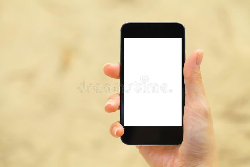 Het lege scherm op mobiel met handholding stock afbeelding