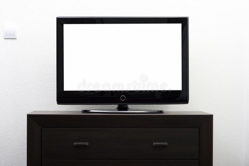 Het lege TVscherm op bruine ladenkast stock afbeeldingen