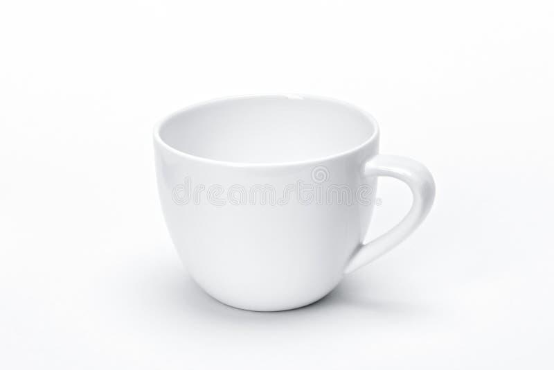 Het lege vaatwerk van het malplaatjeporselein voor uw ontwerp, de witte ceramische witte achtergrond van de theemok royalty-vrije stock afbeeldingen