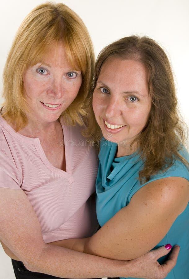 Het lesbische Koesteren van het Paar stock foto