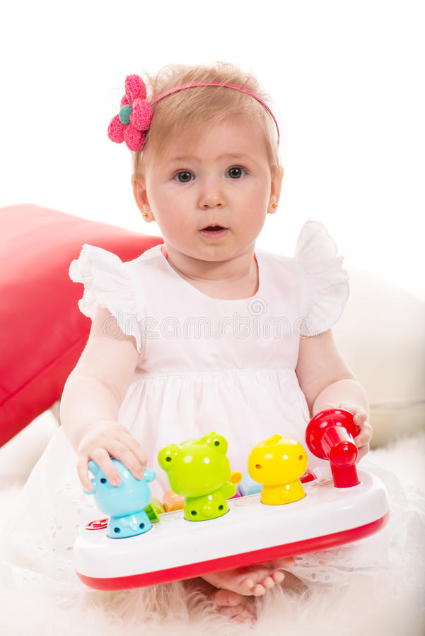 Het leuke babymeisje spelen royalty-vrije stock fotografie