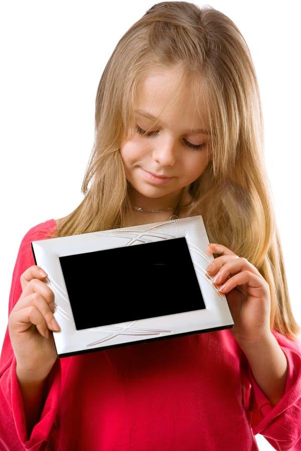 Het leuke frame van de meisje holdingl foto stock foto's