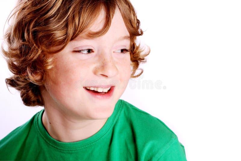 Het leuke jongen glimlachen stock foto