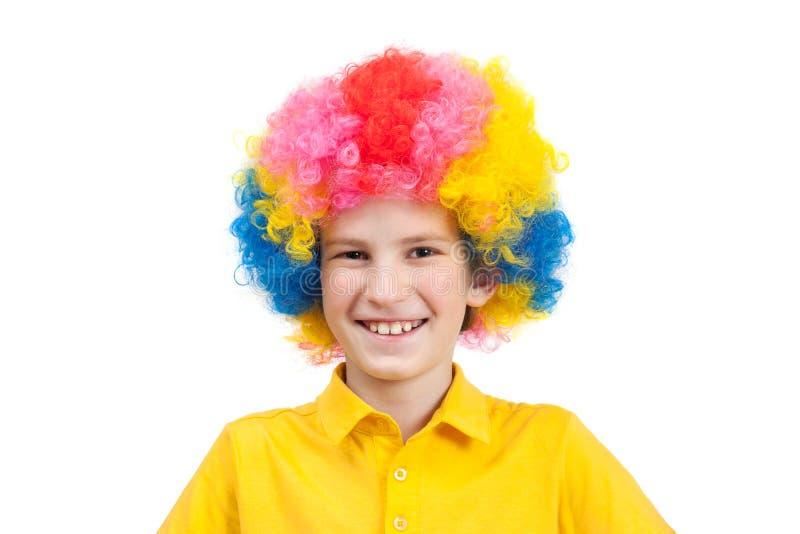 Het leuke kind kleedde zich omhoog in een clownkostuum royalty-vrije stock fotografie