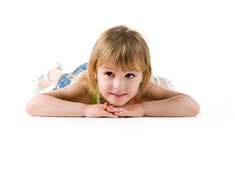 Het leuke meisje ligt op de vloer royalty-vrije stock foto