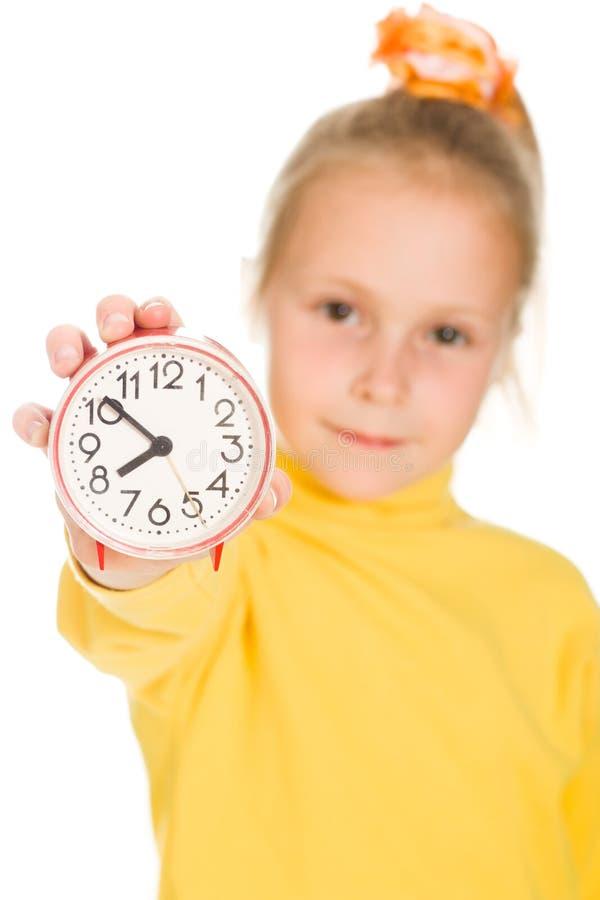 Download Het Leuke Meisje Toont De Klok Stock Foto - Afbeelding bestaande uit kaukasisch, deadline: 29503560