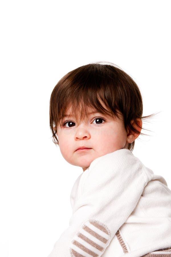Het leuke onschuldige gezicht van de babypeuter royalty-vrije stock fotografie